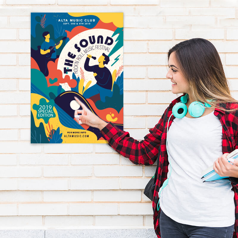 Lady pointing at poster on wall
